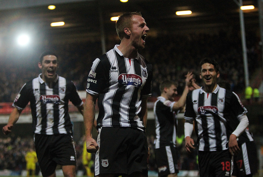 Grimsby Town's Craig Disley celebrates scoring his sides second goal <br /> <br /> Photo by Rich Linley/CameraSport<br /> <br /> Football - FA Challenge Cup Third Round - Grimsby Town v Huddersfield Town - Saturday 4th January 2014 - Blundell Park - Grimsby<br /> <br />  &copy; CameraSport - 43 Linden Ave. Countesthorpe. Leicester. England. LE8 5PG - Tel: +44 (0) 116 277 4147 - admin@camerasport.com - www.camerasport.com