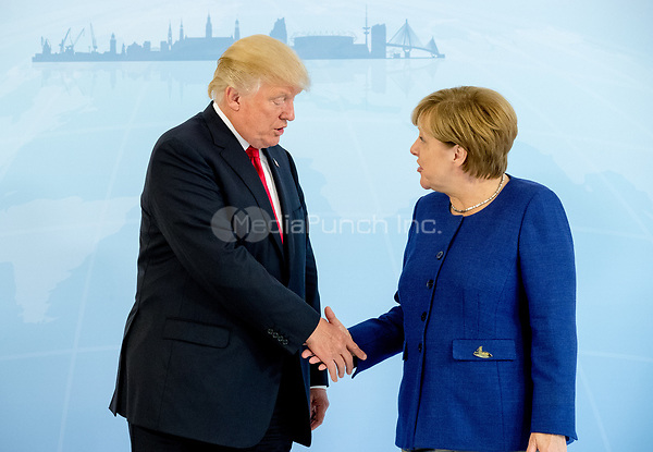 German Chancellor Angela Merkel greets US President Donald Trump ahead of the G20 Summit in the Hotel Atlantic in Hamburg, Germany, 06 July 2017. The G20 Summit of the heads of government and state takes place on 7 and 8 July 2017 in Hamburg. Photo: Michael Kappeler/POOL dpa/dpa /MediaPunch ***FOR USA ONLY***
