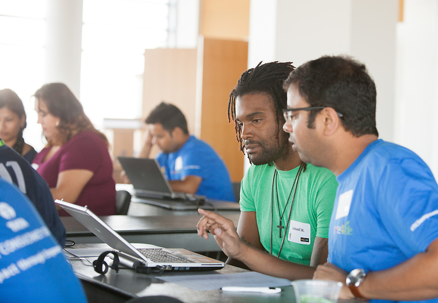 Tata Consultancy Services volunteers provide computer training to SJI program participants.  Day of Caring.