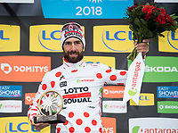 Picture by Alex Broadway/SWpix.com - 11/03/2018 - Cycling - 2018 Paris Nice - Stage Eight - Nice to Nice - Thomas Du Gendt of Lotto Soudal celebrates winning the best climber jersey.<br /> <br /> NOTE : FOR EDITORIAL USE ONLY. THIS IS A COPYRIGHT PICTURE OF ASO. A MANDATORY CREDIT IS REQUIRED WHEN USED WITH NO EXCEPTIONS to ASO/Alex Broadway MANDATORY CREDIT/BYLINE : ALEX BROADWAY/ASO