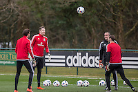 Wales goalkeeping team (l-r) Daniel Ward, Wayne Hennessey, coach Martyn Margetson and Owain Fon Williams during Wales national team training ahead of the International Friendly match and Euro 2016 warm up match against Northern Ireland at Vale Resort, Hensol, Wales on 22 March 2016. Photo by Mark  Hawkins / PRiME Media Images.