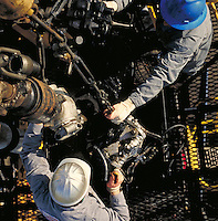 overhead view of roughnecks on oil drilling platform