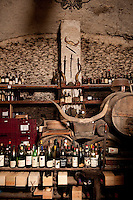 The cellar at 'Checchino' restaurant, carved into the side of Mount Testaccio and the ancient pile of discarded olive oil amphoras.  Horns on display from the neighbouring abattoir, Checchino was a popular canteen for the abattoir workers dating 1887, in the Testaccio district of Rome, Italy