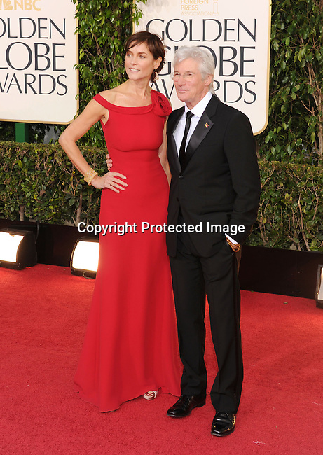 BEVERLY HILLS, CA - JANUARY 13: Carey Lowell and Richard Gere arrive at the 70th Annual Golden Globe Awards held at The Beverly Hilton Hotel on January 13, 2013 in Beverly Hills, California.