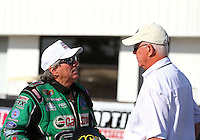Mar 16, 2014; Gainesville, FL, USA; NHRA funny car driver John Force (left) talks with official Graham Light during the Gatornationals at Gainesville Raceway Mandatory Credit: Mark J. Rebilas-USA TODAY Sports