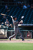 Salt River Rafters designated hitter Drew Ellis (13), of the Arizona Diamondbacks organization, follows through on his swing during an Arizona Fall League game against the Surprise Saguaros on October 9, 2018 at Surprise Stadium in Surprise, Arizona. The Rafters defeated the Saguaros 10-8. (Zachary Lucy/Four Seam Images)