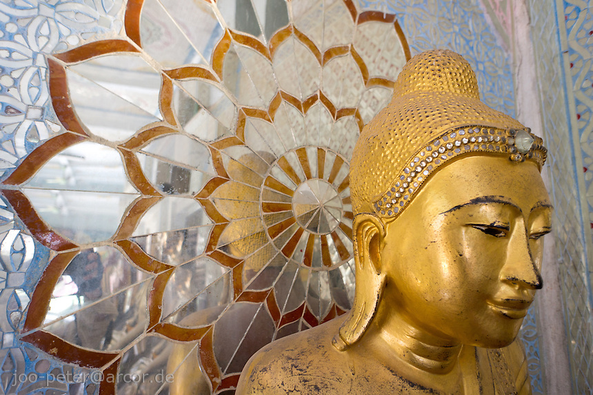 golden buddha statue with mirror mosaic as halo in pagoda next to Shwekyimyint pagoda ,Mandalay, Myanmar, 2011