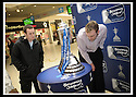 24/02/2009  Copyright Pic: James Stewart.File Name : sct_jspa22_scottis_cup.SHOPPERS IN THE MALL SHOPPING CENTRE, FALKIRK, STOP TO HAVE A LOOK AT THE HOMECOMING SCOTLAND SCOTTISH CUP AS IT CONTINUES IT'S TOUR OF SCOTLAND.....Press Release..... A unique interactive tour to engage primary school children with football and the Homecoming Scottish Cup rolls into town today, Tuesday 24 February 2009 at St Margaret's Primary School in Falkirk.  . .Up to 100 pupils in primaries 5 to 7 at each local school will receive specialist skills and drill training from Scottish Football Association coaches as well as getting the chance to view the Homecoming Scottish Cup trophy itself.. .The school tour takes the form of a giant 'football-shaped' tent, which houses the world's oldest footballing trophy and information about Homecoming Scotland and the Scottish Cup tournament.. .Future football stars will be given soccer skills training ahead of watching their home team, Falkirk, take on Inverness Caledonian Thistle in the quarter finals of the Homecoming Scottish Cup on the weekend of 7 March.. .Falkirk legend Alex Totten, who used to manage the side, will be on hand at St Margaret's Primary School to share his knowledge and experience with the kids and to see the trophy himself.. .All primary schools in Scotland will also be sent education packs to encourage pupils to know more about Homecoming Scotland and to learn more about healthy eating, fitness and playing football as a way to keep fit and have fun.  . .As part of the football celebrations, the tour will then encourage locals in the town centre to get behind their local team, when the cup visits The Mall in Falkirk later in the afternoon.. .The Homecoming Scottish Cup Tour has been designed to engage with Scotland's local communities and spread the message about joining in the celebrations for Homecoming Scotland 2009, a programme comprising over 300 events to celebrate Scotland's culture, heritage and its people. Further Inf