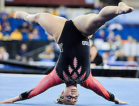 Nebraska's Jennifer Lauer competes on the floor exercise during the semifinals of the NCAA women's gymnastics championships, Friday, April 17, 2015 in Fort Worth, Tex.(Mo Khursheed/TFV Media via AP Images)