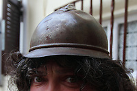 This is a photo of myself, made by a friend of mines, with a helmet of the first world war, that was recovered on the Karst. You can only see my green eyes, and (already) quite a lot of white hair. Nevertheless, if you like the image, you can use it for advertising / advertisement, too (you'll find the file to download in the same collection). Please note that it was made as a minimizing game, as it should be clear by my perplexed expression.