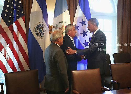United States President Barack Obama (R) shakes hands with President Otto Perez Molina (2nd L) of Guatemala, as President Salvador Sanchez Ceren (L) of El Salvador looks on at the end of their meeting in the Cabinet Room of the White House July 25, 2014 in Washington, DC. The leaders met to discuss the current situation of migrant children traveling alone to the U.S.  <br /> Credit: Alex Wong / Pool via CNP