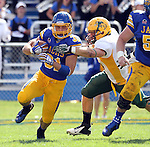 BROOKINGS, SD - SEPTEMBER 28:  Zach Zenner #31 from South Dakota State University is brought down from behind by Grant Olson #34 from North Dakota State University in the first quarter of their game Saturday afternoon at Coughlin Alumni Stadium in Brookings. (Photo by Dave Eggen/Inertia)