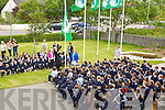 GREEN-FLAG: It was a great day for Ardfert NS as principal Betty Stack invited Michéal O Muircearthaigh to raised their 5th Green Flag on Friday as pupils and teachers looked on.