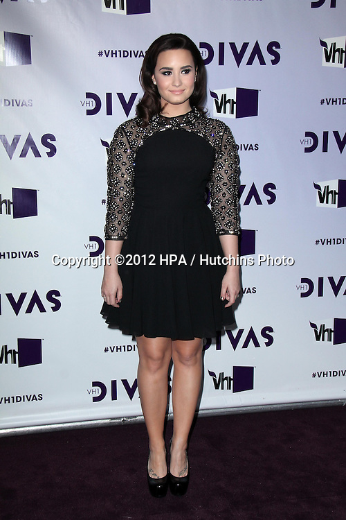 LOS ANGELES - DEC 16:  Demi Lovato arriving at the VH1 Divas Concert 2012 at Shrine Auditorium on December 16, 2012 in Los Angeles, CA