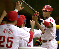 Philadelphia Phillies' Jimmy Rollins (11) celebrates with his teammates in the dug out after scoreing a run after Phillies Pat Burrell drew a bases loaded walk off Baltimore Orioles pitcher Willis Roberts in the first inning of play in Philadelphia Friday, June 15, 2001 (AP Photo/Brad C. Bower)