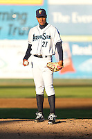 Jeffeson Medina #27 of the Everett AquaSox toes the rubber during a game against the Tri-City Dust Devils at Everett Memorial Stadium in Everett, Washington on July 28, 2014. Tri-City defeated Everett 6-5 in 11 innings.  (Ronnie Allen/Four Seam Images)