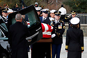 The flag-draped casket of former President George H.W. Bush is carried by a joint services military honor guard into a State Funeral at the National Cathedral, Wednesday, Dec. 5, 2018, in Washington. <br /> Credit: Alex Brandon / Pool via CNP