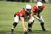 January 5th, 2008:  Ball State lineman Dan Gerberry (52) and Michael Switzer (74) prepare to block before a play during the fourth quarter of the International Bowl at the Rogers Centre in Toronto, Ontario Canada...Rutgers defeated Ball State 52-30.  ..Photo By:  Mike Janes Photography