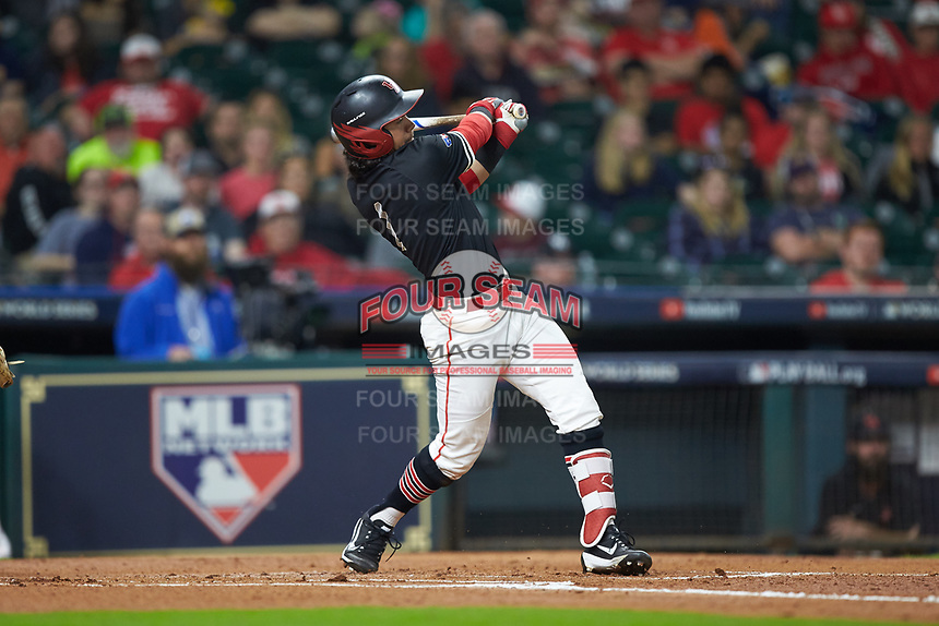 Rey Fuentes III (1) of the Houston Cougars follows through on his swing against the Mississippi State Bulldogs in game six of the 2018 Shriners Hospitals for Children College Classic at Minute Maid Park on March 3, 2018 in Houston, Texas. The Bulldogs defeated the Cougars 3-2 in 12 innings. (Brian Westerholt/Four Seam Images)