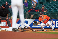 Pavin Smith (10) of the Virginia Cavaliers wait for a pick-off throw as Jalen Phillips (22) of the Duke Blue Devils dives bag to first base in Game Seven of the 2017 ACC Baseball Championship at Louisville Slugger Field on May 25, 2017 in Louisville, Kentucky. The Blue Devils defeated the Cavaliers 4-3. (Brian Westerholt/Four Seam Images)