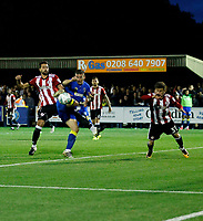 Brentford's Yohan Barbet stops AFC Wimbledon's Cody McDonald getting a shot on goal during the Carabao Cup match between AFC Wimbledon and Brentford at the Cherry Red Records Stadium, Kingston, England on 8 August 2017. Photo by Carlton Myrie.