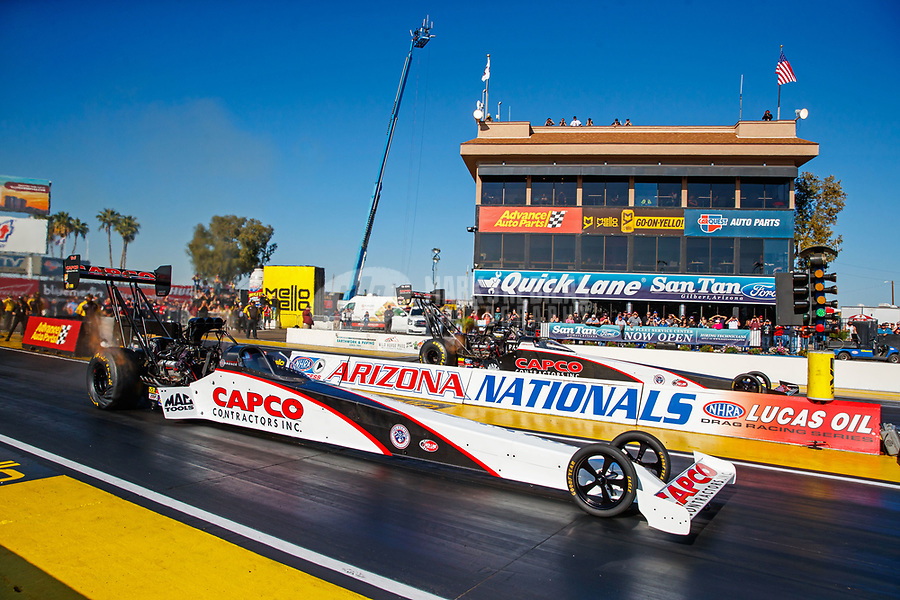 Feb 25, 2018; Chandler, AZ, USA; NHRA top fuel driver Steve Torrence (near) races alongside father Billy Torrence during the Arizona Nationals at Wild Horse Pass Motorsports Park. Mandatory Credit: Mark J. Rebilas-USA TODAY Sports