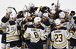 Buffalo Sabres defenseman Marco Scandella (6) is surrounded by teammates after scoring in overtime against the Detroit Red Wings in an NHL hockey game, Thursday, Feb. 22, 2018, in Detroit.  The Sabres defeated the Red Wings, 3-2.  (AP Photo/Jose Juarez)