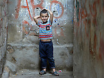 A boy in the Shatila refugee camp in Beirut, Lebanon, where refugees of Syria's civil war have moved in alongside Palestinians who have lived here for decades. Lebanon hosts some 1.5 million refugees from Syria.