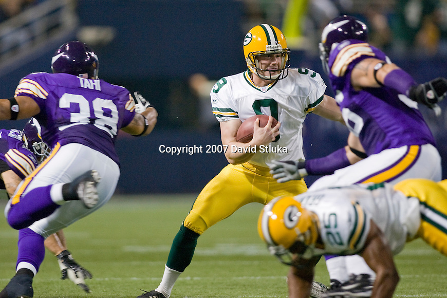Punter Jon Ryan #9 of the Green Bay Packers scrambles for a first down on a fake punt during an NFL football game against the Minnesota Vikings at Hubert H. Humphrey Metrodome on September 30, 2007 in Minneapolis, Minnesota. The Packers beat the Vikings 23-16. (Photo by David Stluka)