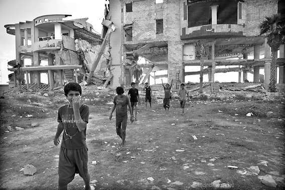 2010 july 2 Gaza - Gaza City.<br /> Kids playing in front of Al Jazeera Hotel, badly destroyed during operation 'Cast Lead', the Israeli attack on Gaza during the winter of 2008-2009.