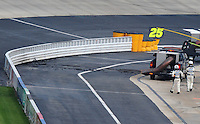 May 31, 2008; Dover, DE, USA; Nascar Nationwide Series officials look on after a track drier blew up the asphalt on pit road prior to the Heluva Good 200 at the Dover International Speedway. Mandatory Credit: Mark J. Rebilas-US PRESSWIRE