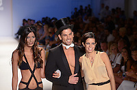 Designer Naila Chbib, Alice Panikian and Male Model walk runway at Naila Collection Swimwear Show during Mercedes Benz IMG Fashion Swim Week 2013 at The Raleigh Hotel, Miami Beach, FL on July 23, 2012