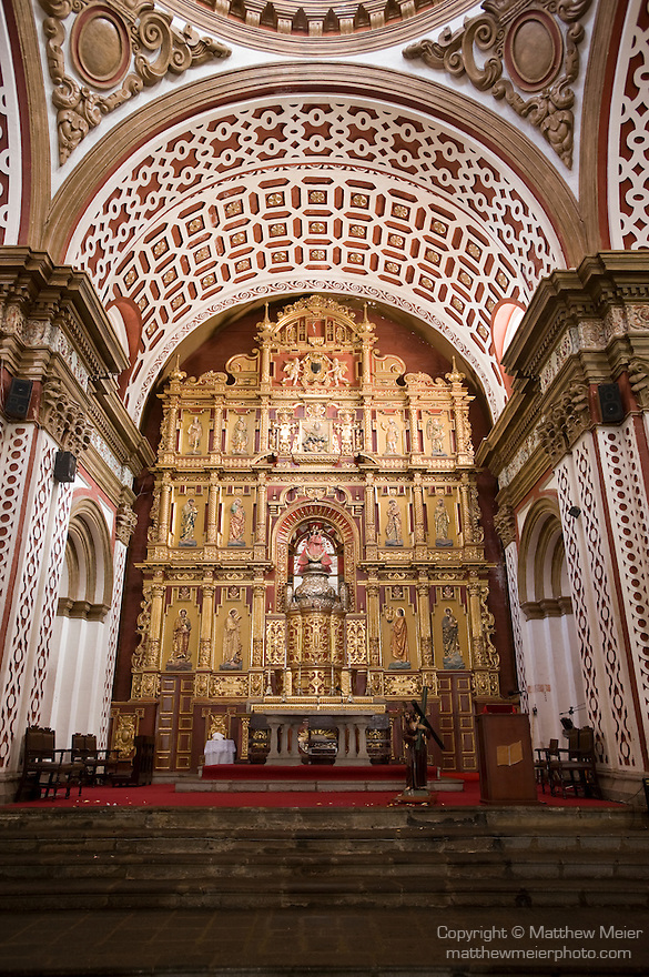 Iglesia de Guapulo, Quito, Ecuador; interior views of Iglesia de Guapulo (Guapulo Church), showing the ornate design and craftsmanship, The present building was begun in 1649, under Brother Antonio Rodríguez. The church is large and imposing, with a single nave in the form of a latin cross, 190 feet by 90, and covered by a great central dome. The facade is of a simple neo-classical style, with a two-towered belfry. It is situated on a small plateau among the range of hills that separates Quito from the Tumbaco valley. It is surrounded by deep gorges, and stands beside the road taken by Pizarro's expedition that was to discover the Amazon. The figure of Our Lady' of Guadalupe which is worshipped there was carved by Diego de Robles, and polychromed by Luis de Rivera. The pulpit of the Guapulo Church, Quito is considered the most beautiful pulpit in the entire continent of South America. The Guapulo Church, Quito is reckoned as one of the most famous tourist attractions in Quito. , Copyright © Matthew Meier, matthewmeierphoto.com All Rights Reserved