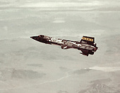 X-15A-2 with dummy ramjet  in flight in the early 1960s.This joint program by the National Aeronautics and Space Administration (NASA), the United States Air Force, the United States Navy, and North American Aviation, Inc. operated the most remarkable of all the rocket research aircraft. Composed of an internal structure of titanium and a skin surface of a chrome-nickel alloy known as Inconel X, the X-15 had its first, unpowered glide flight on June 8, 1959, while the first powered flight took place on September 17, 1959. Because of the large fuel consumption of its rocket engine, the X-15 was air launched from a B-52 aircraft at about 45,000 ft and speeds upward of 500 mph. The airplane first set speed records in the Mach 4-6 range with Mach 4.43 on March 7, 1961; Mach 5.27 on June 23, 1961; Mach 6.04 on November 9, 1961; and Mach 6.7 on October 3, 1967. It also set an altitude record of 354,200 feet (67 miles) on August 22, 1963, and provided an enormous wealth of data on hypersonic air flow, aerodynamic heating, control and stability at hypersonic speeds, reaction controls for flight above the atmosphere, piloting techniques for reentry, human factors, and flight instrumentation. The highly successful program contributed to the development of the Mercury, Gemini, and Apollo piloted spaceflight programs as well as the Space Shuttle program. The program's final flight was performed on October 24, 1968.