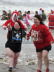 Suzi and Mary Duffy who took part in the Polar Plunge in aid of the Special Olympics at Clogherhead beach, County Louth. Photo:Colin Bell/pressphotos.ie