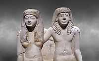Ancient Roman statue of Pendua and his wife Nefertari, limestone, New Kingdom, 19th Dynasty, (1292-1186 BC),  Deir-el-Medina, Thebes. Egyptian Museum, Turin. Grey background.<br /> <br />  Carved in Thebian white limestone the statue of Pendua and his wife Nefertari shows the skill and attention to details of the sculptors of Deir-el-Medina, the worker's village of those who built the Royal Tombs at Thebes. The theme of the family is echoed by a carving of a daughter between the two figures.