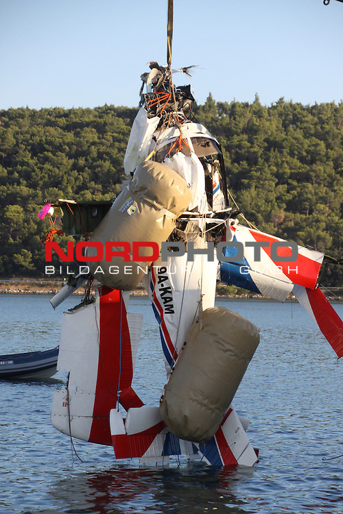 02.09.2013., Pomer, Croatia  - Two men have been killed in a crash of a small plane that has plunged into the Adriatic Sea.The pilot and the passenger of the two-seat aerobatic Zlin aircraft were pulled from the wreckage of the plane, which crashed Sunday into shallow water near the northern town of Pula.The cause of the accident was being investigated.Removing aircraft from the sea is in progress<br /> <br /> Foto &not;&copy;  nph / PIXSELL / Dusko Marusic