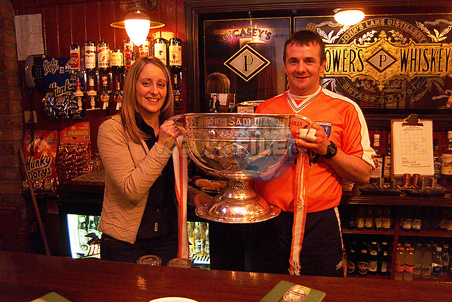 Jenny and Paddy Cowley, with The Sam Maguire Cup in O'Casey's Trinity Street. ..Pic Newsfile
