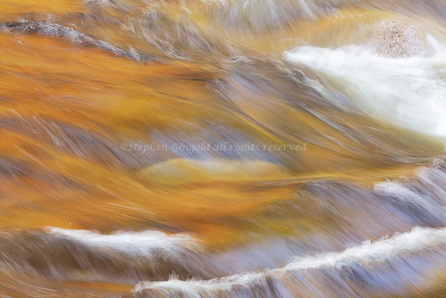 Strong autumn colors reflect in the Swift River along the Kancamagus Highway.