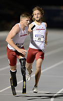 NWA Democrat-Gazette/ANDY SHUPE<br /> Arkansas' Hunter Woodhall (left) receives the baton Saturday, May 11, 2019, from John Winn as they compete in the 4x400-meter relay during the SEC Outdoor Track and Field Championships at John McDonnell Field in Fayetteville. Visit nwadg.com/photos to see more photographs from the meet.