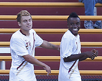 Boston College midfielder Derrick Boateng (7) celebrates his goal with teammate.  Boston College defeated University of Rhode Island, 4-2, at Newton Campus Field, September 25, 2012.