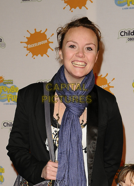 "CHARLIE BROOKS & GUEST.At the ""Spongebob Squarepants - The Sponge who could Fly"" Gala performance at the Hammersmith Apollo, London, England. .March 5th 2009 .half length black leather jacket blue scarf white .CAP/CAN.©Can Nguyen/Capital Pictures."