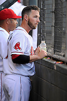 Boston Red Sox shortstop Stephen Drew (7) watches from the dugout for the Class A Greenville Drive on a tuneup assignment in a game against the Augusta GreenJackets on Friday, May 23, 2014, at Fluor Field at the West End in Greenville, South Carolina. (Tom Priddy/Four Seam Images)