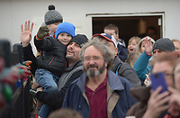 NWA Democrat-Gazette/ANDY SHUPE<br /> Jonathan Leonard of Springdale smiles Saturday, Dec. 1, 2018, as he holds his son, Noah Leonard, 3, while they and other families greet the train as it returns to the depot during the annual Christmas Train at the Arkansas &amp; Missouri Railroad in Springdale. The event features a 40-minute ride to Johnson and back aboard a 1940s-era passenger car with Christmas carols. Santa Claus sat for photographs with families in a caboose while games and pony rides were available at the depot.