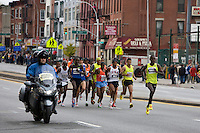 Patrick Makau leads the pack of Men's Elite runners, followed by Meb Keflezighi (USA, l) as they approach Mile 7 in the ING New York City Marathon.