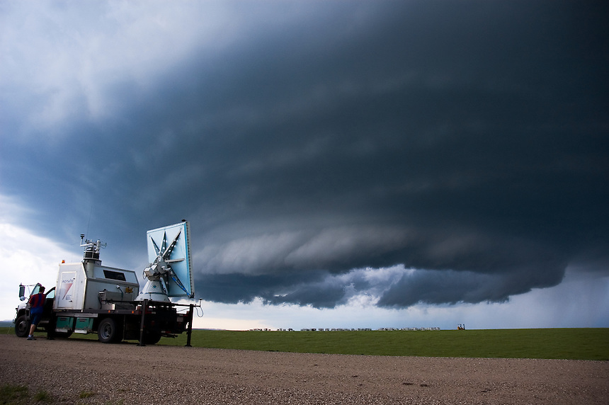 Approaching supercell thunderstorm being scanned by a project ROTATE rapid scan Doppler On Wheels radar. The special flat antenna design consists of a slotted waveguide array which allows simultaneous multiple beams to be emitted at different elevation angles to better analyze wind motions in the storm.