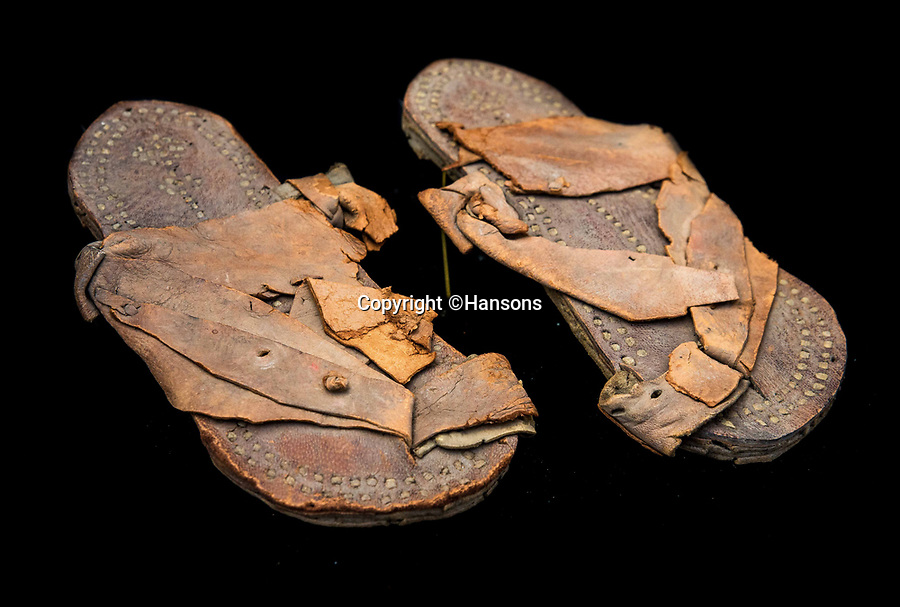 BNPS.co.uk (01202 558833)Pic: Hansons/BNPS<br /> <br /> Historic footwear.<br /> <br /> An extraordinary archive of items relating to legendary soldier Lawrence of Arabia has emerged...Including the desert hero's arabian sandals!<br /> <br /> The collection has come from Rodney Havelock Walker whose parents were friends of the enigmatic T E Lawrence and lived near his Clouds Hill home in Dorset.<br /> <br /> As well as the leather sandal's there is a early edition of the Seven Pillers of Wisdom, a school prize book presented to Lawrence in 1903 and a photograph of Cyrene taken by Lawrence before the war.<br /> <br /> Also included is a poignant christening picture of Rodney Havelock Walker on 10th November 1935, its annotated by his parents as being in Lawrence's own christening robes. The war hero had died in suspicious circumstances just 7 months earlier.<br /> <br /> Hansons - December 19th -  Est £3000.