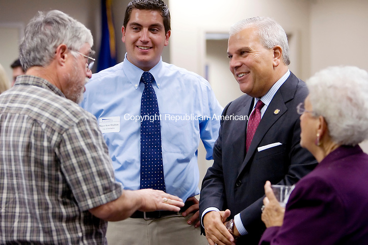 TORRINGTON, CT- 03 OCT 2007- 100307JT04- <br /> From left, Gerry Zordan of Borgeson Universal Company, Inc. in Torrington, Torrington Mayor Ryan Bingham, Lt. Gov. Michael Fedele, and former chairman of the Republican Town Committee Ann Giannattasio chat during a meet &amp; greet event at Northwest Connecticut's Chamber of Commerce office in Torrington on Wednesday. The event was sponsored by West State Mechanical, Inc. and ConnectiCare.<br /> Josalee Thrift / Republican-American