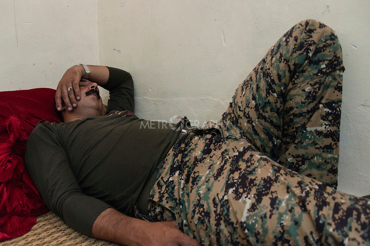 19/07/14  Iraq -- Daquq, Iraq -- Awat, a Peshmerga fighter, sleeps at the peshmerga base.