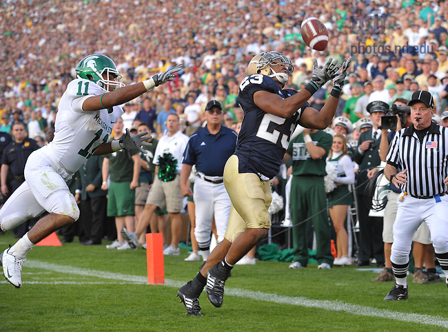 Sept. 19, 2009; South Bend, IN, USA; Notre Dame Fighting Irish wide receiver Golden Tate (23) catches a touchdown pass in front of Michigan State Spartans safety Marcus Hyde (11) in the fourth quarter at Notre Dame Stadium. Notre Dame won 33-30. Photo by Matt Cashore